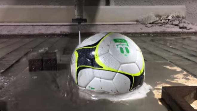 WaterJet Cuts through sports balls
