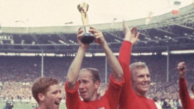 Sir Bobby Charlton Lifting the World Cup