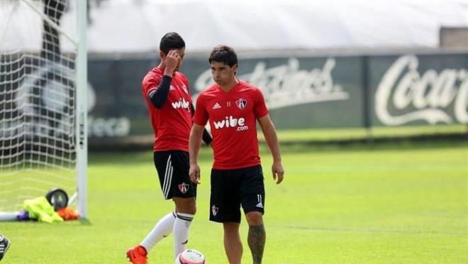 Matías Alustiz and teammate contemplate their horrific season