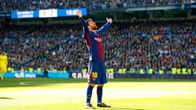 Lionel Messi celebrates a 3-0 victory in El Clasico