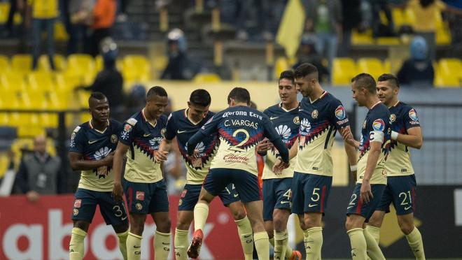 A happy Club America team huddles up after a goal