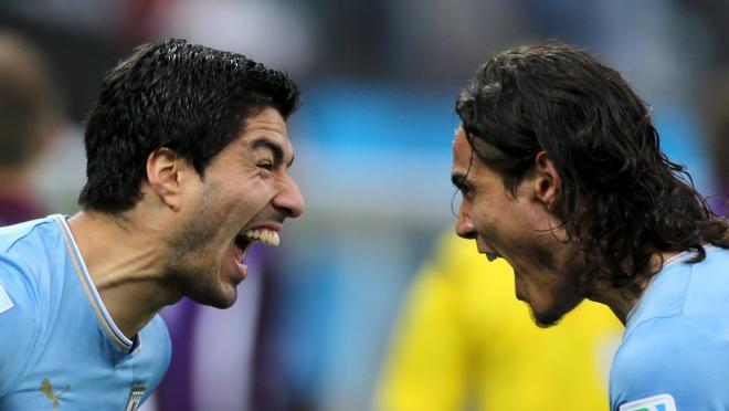 Suarez and Uraguay teammate celebrate a goal