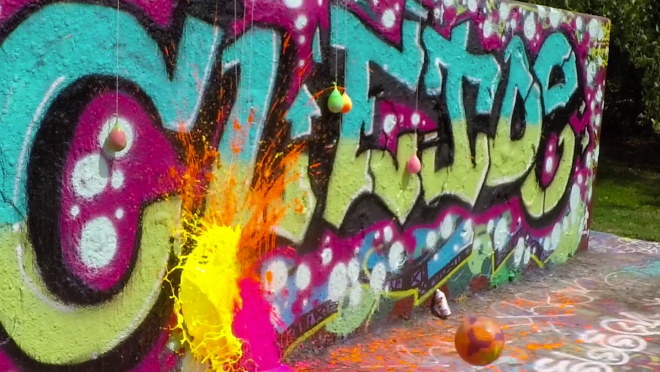 Popping Paint Balloons Hanging On A Graffiti Wall