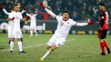 Robert Lewandowski celebrates his goal against Freiburg