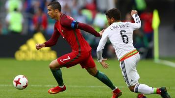 Cristiano Ronaldo takes on Jonathan dos Santos