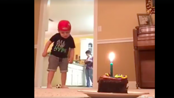 Kid extinguishes candle with soccer ball