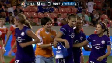 A pitch invader goes after Alex Morgan.