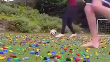 Playing Football On A Pitch Full Of Legos Looks Painful AF
