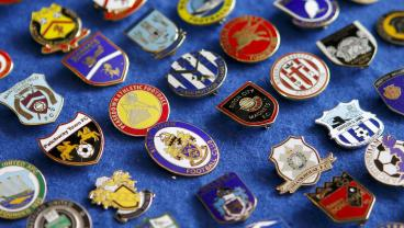 25 Historically Overlooked Badges From Yesteryear