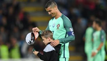 Child Pitch Invader Hugs Ronaldo