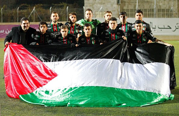 Deportivo Palestino displays the Palestinian flag