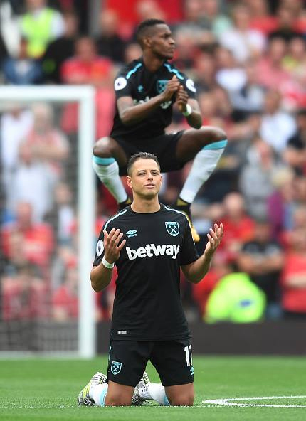 Chicharito kneels after he misses a goal