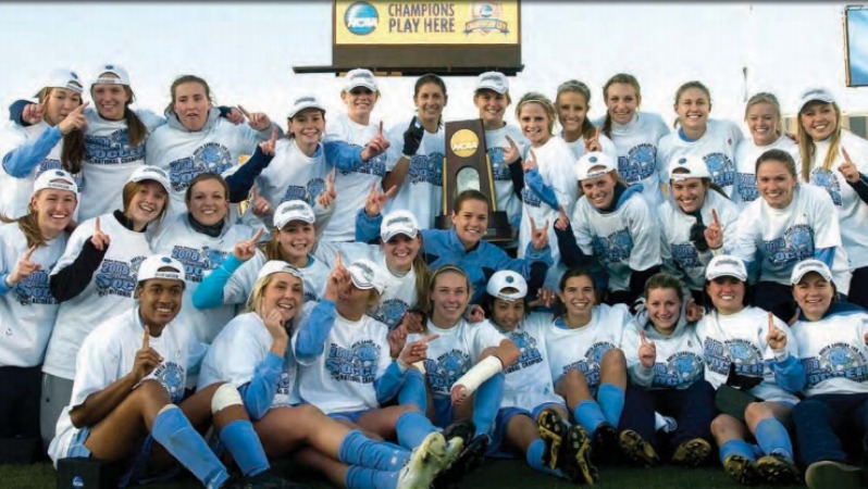 the 2008 UNC national championship team. Yael is pictued without a hat in the center.