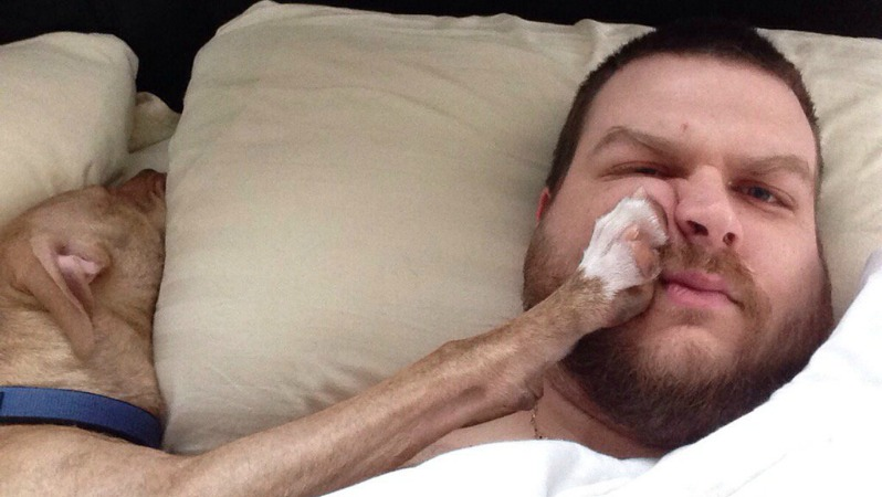 Get in amazing shape by not getting bad sleep like this guy who has his dog's paw in his face.